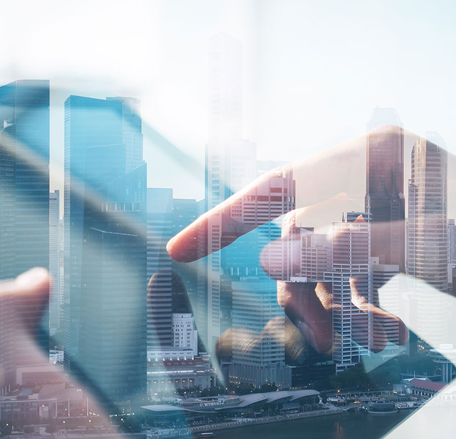 double exposure of city and hands using a tablet